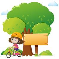 Modèle de panneau en bois avec fille faire du vélo vecteur