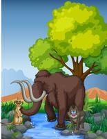 Mammouth et suricate au bord de la rivière