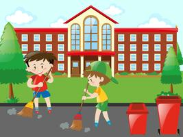 Enfants balayant la route