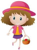 Petite fille tenant un panier de fruits vecteur