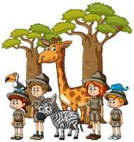 Enfants en tenue de safari avec de nombreux animaux vecteur