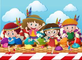 Enfants jouant aux indiens dans le monde des bonbons