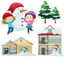 Ensemble d'hiver avec des enfants et des maisons vecteur