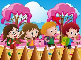 Enfants en randonnée dans le monde des bonbons