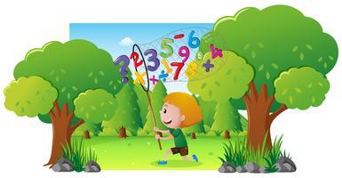 Scène avec garçon attraper des numéros dans le parc