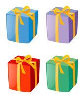 Quatre boîtes de cadeaux vecteur