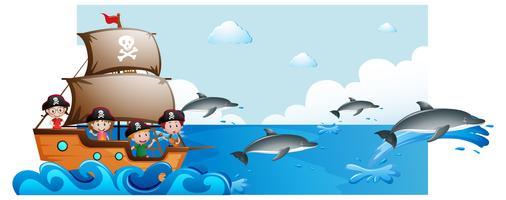 Scène de l'océan avec des enfants sur le bateau et les dauphins sous l'eau