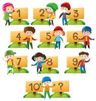 Enfants et chiffres sur une planche de bois