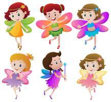 Six fées aux ailes colorées vecteur
