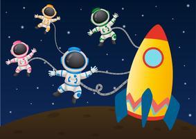 Quatre astronaunts volant dans l'espace