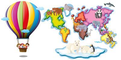 Carte du monde avec animaux et montgolfière vecteur
