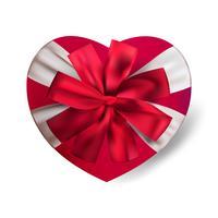 Boîte de cadeau forme vecteur coeur rouge réaliste isolé sur fond blanc avec archet