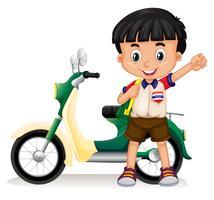 Petit garçon et moto vecteur
