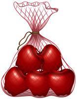 Pommes rouges dans le sac