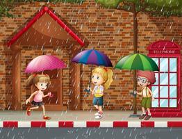 Trois enfants sous la pluie
