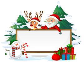 Père Noël sur une planche de bois