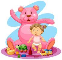Bébé fille et ours en peluche rose