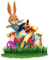 Lapin mignon et oeufs de Pâques dans le jardin