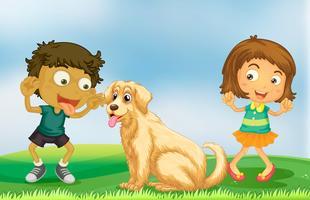 Fille et garçon jouant avec un chien