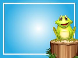 Modèle de cadre avec une grenouille heureuse sur le journal