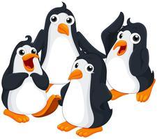 Quatre pingouins au visage heureux