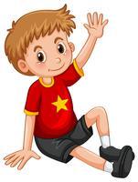 Petit garçon agitant la main bonjour vecteur