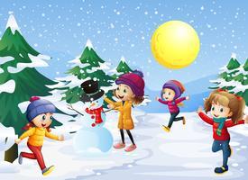 Enfants jouant dans la neige à Noël vecteur