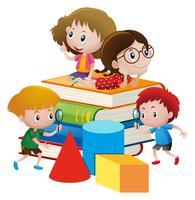 Quatre enfants sur des livres géants