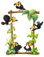 Toucan sur cadre en bois