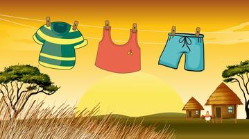 Vêtements suspendus dans le fil vecteur