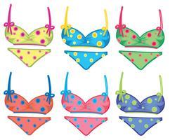 Bikinis à pois colorés vecteur