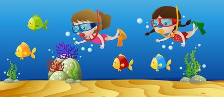 Deux filles plongeant sous l'océan vecteur