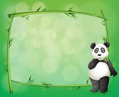 Un panda à côté d'un cadre en bambou vecteur