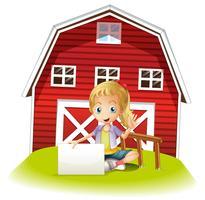 Une fille assise devant la grange tenant un panneau vide