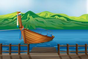Un bateau en bois attaché au port vecteur