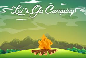 Terrain de camping avec feu de camp dans le champ