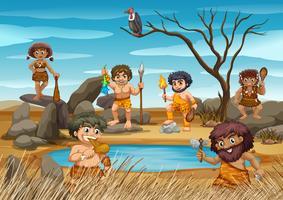 Cavemen vivant au bord de l'étang