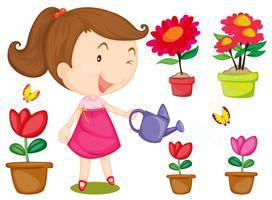 Petite fille arrosant des fleurs