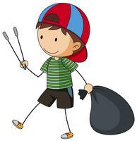 Garçon avec sac à ordures et pinces