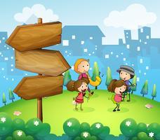 Musiciens se produisant près des flèches de bois vecteur