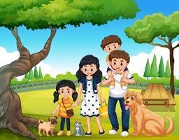 Une famille heureuse au parc vecteur
