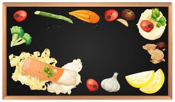 Pâtes au saumon et élément sur tableau noir