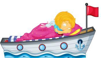 Une fille dort dans un bateau avec une couverture rose