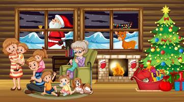 Famille assis autour d'un arbre de Noël