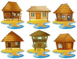 Différents modèles de chalets sur les îles vecteur