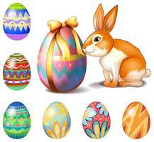 Sept oeufs de Pâques et un lapin