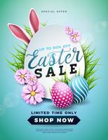 Illustration de vente de Pâques avec des oeufs peints en couleur, des fleurs de printemps et des oreilles de lapin sur fond bleu
