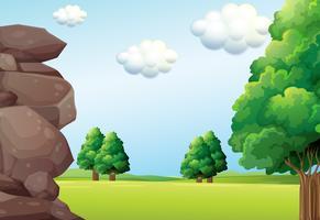 Scène de la nature avec champ vert vecteur