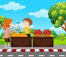 Garçon vendant des fruits sur le trottoir