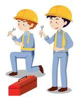 Deux mécaniciens avec coffre à outils vecteur